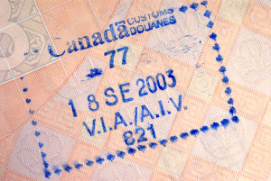 Canada customs immigration entry stamp on the inside page of a passport.